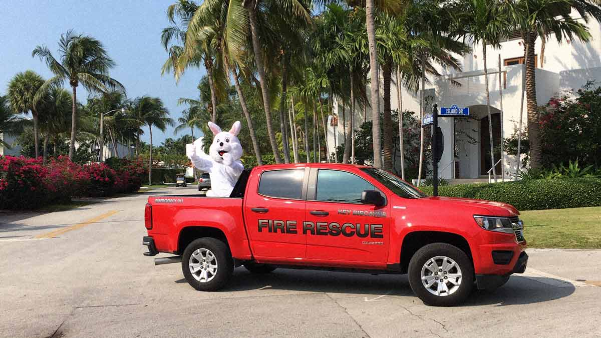 Easter bunny rides in the back of a pickup truck during coronavirus lockdown in Key Biscayne, April 2020