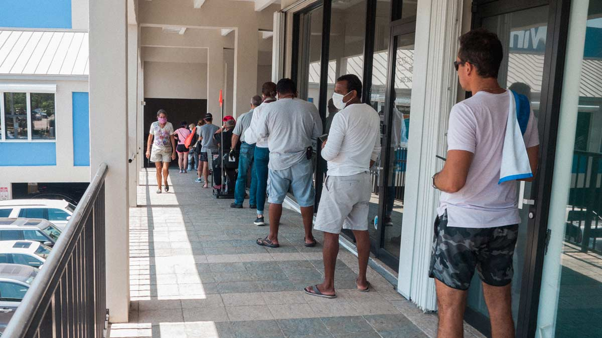 Waiting in line to enter the Winn Dixie in Key Biscayne because of coronavirus, April 2020