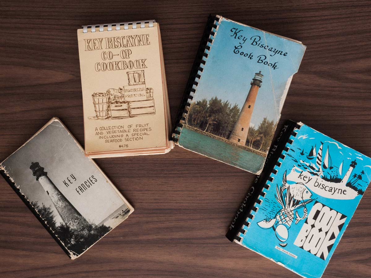 Collection of Key Biscayne cookbooks.