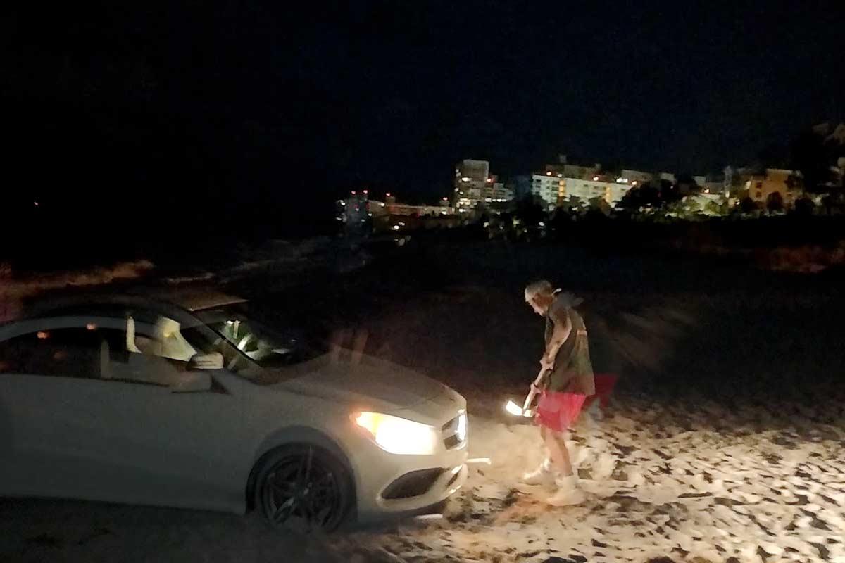 car stuck in sand key biscayne beach december 2020