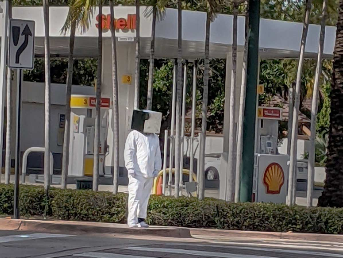 Man with box on head Crandon blvd Feb 2021