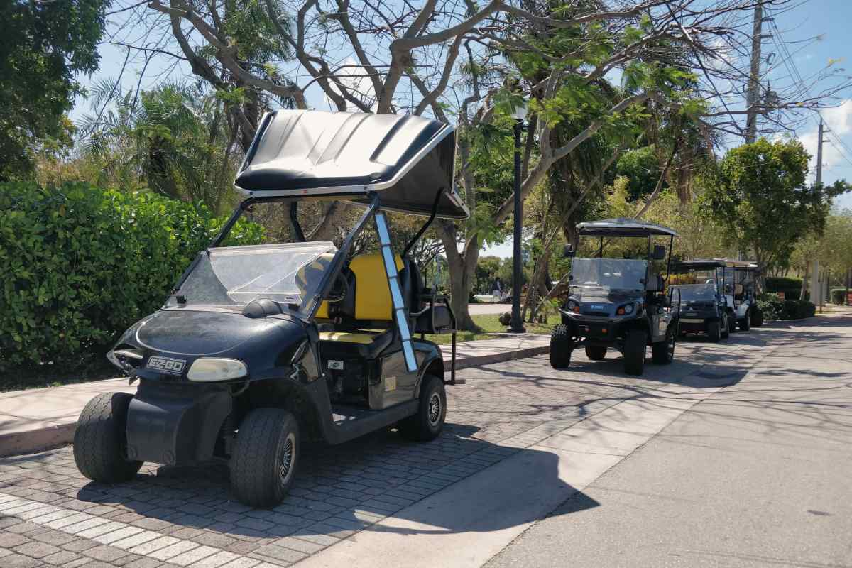 Busted golf carts lined up at the Village Green Key Biscayne