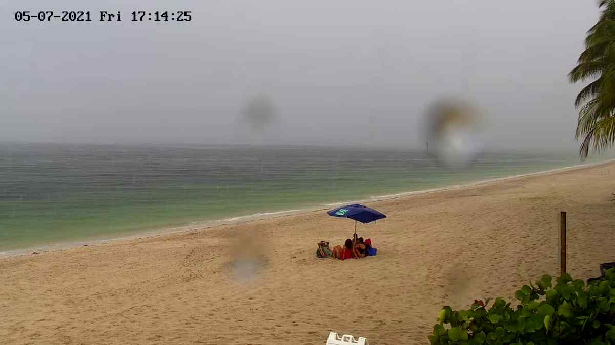 Caught in the rain Key Biscayne beach May 2021